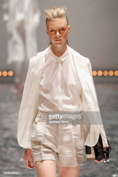 A model walks down the runway during the Tiger of Sweden S/S 2013 Fashion Show during the MercedesBenz Stockholm Fashion Week on August 29 2012 in...