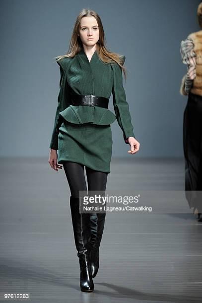 Model walks down the runway during the Valentin Yudashkin fashion show as part of Paris Womenswear Fashion Week Fall/Winter 2011 on March 10, 2010 in...