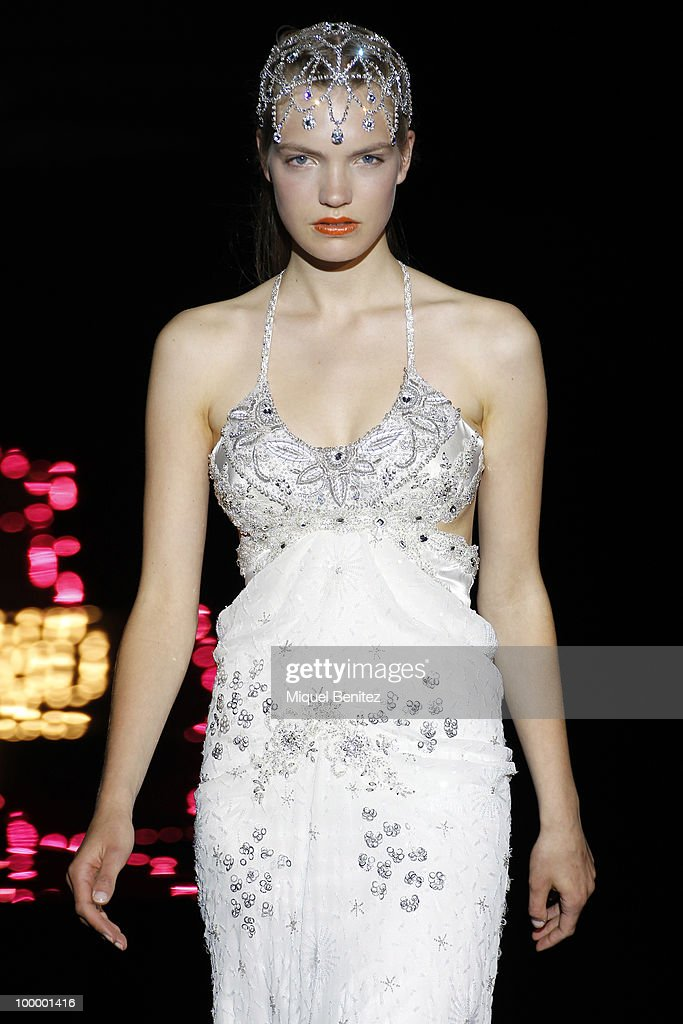 A model walks down the runway during Yolan Cris fashion show at Barcelona Bridal Week 2010 on May 19, 2010 in Barcelona, Spain.