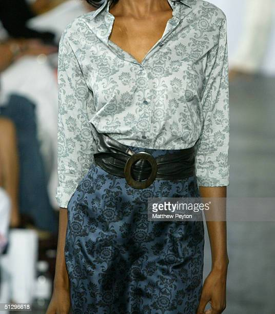A model walks down the runway in the Derek Lam show during the Olympus Fashion Week Spring 2005 at Industria September 12 2004 in New York City