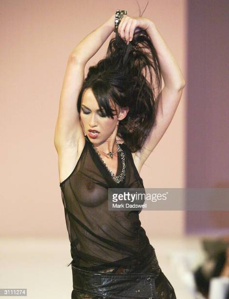 A model walks down the runway in the Designer Show during the L'Oreal Melbourne Fashion Festival at the Sofitel Hotel on March 19 2004 in Melbourne...