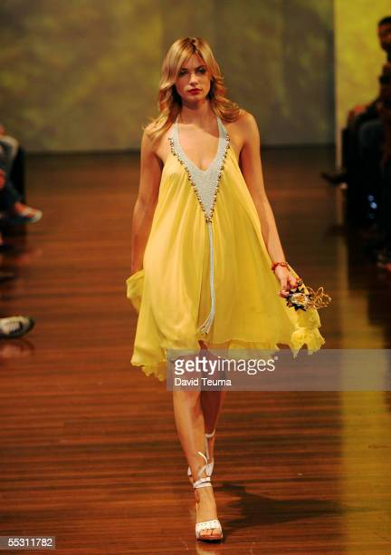 A model walks down the runway in the Jet Set fashion show wearing a Nicola Finetti design during Motorola Melbourne Spring Fashion Week at the...