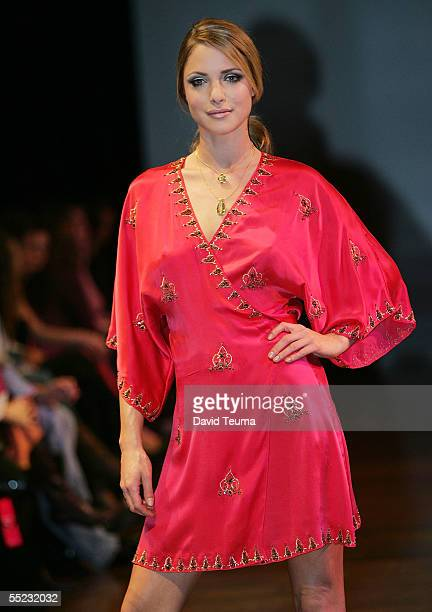 A model walks down the runway wearing a Bare/Rebecca Davies design in the City Slick fashion show during Motorola Melbourne Spring Fashion Week at...