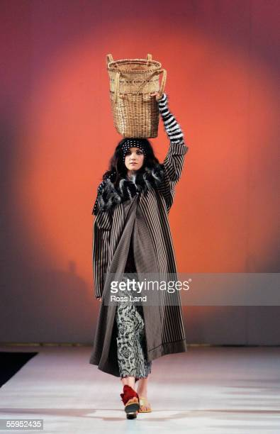 A model walks down the runway wearing Madcat during the Bombay Saphire Group Two show at Air the New Zealand Fashion Week day two event at the...