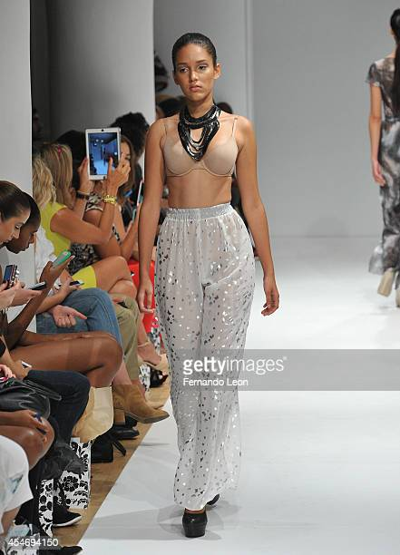 A model walks down the runway wearing Treasure Simmons designs during the Swimwear Collective fashion show at Helen Mills Event Space on September 5...