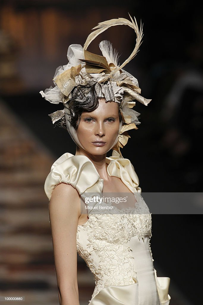 A model walks down the runwayduring Victorio & Lucchino fashion show during the Barcelona Bridal Week on May 19, 2010 in Barcelona, Spain.