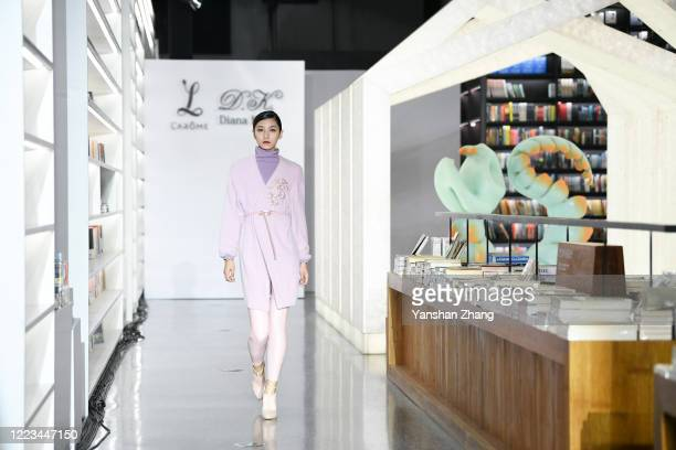 A model walks during the Larome DIANA KWAN collection show by Chinese designers Yifan Chen Yue Guan during the China Fashion Week 2020/2021 A/W...