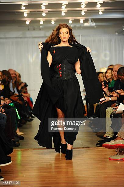 A model walks during the Mischka Velasco presentation during MercedesBenz Fashion Week Fall 2014 at Top of the Garden on February 10 2014 in New York...