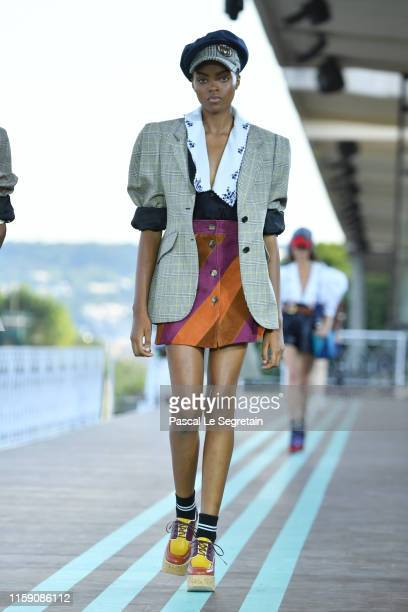 model walks during the runway miu miu club show at Hippodrome d'Auteuil on June 29 2019 in Paris France