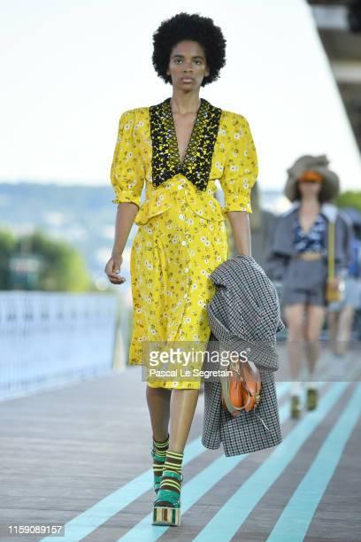 model walks during the runway miu miu club show at Hippodrome d'Auteuil on June 29 2019 in Paris France