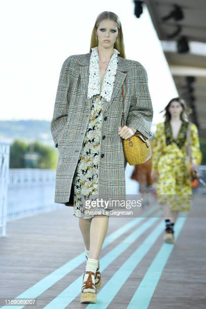 Model walks during the runway miu miu club show at Hippodrome d'Auteuil on June 29, 2019 in Paris, France.