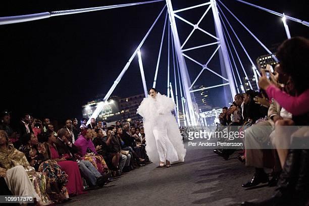 A model walks for the designer David Tlale on the Nelson Mandela Bridge at the Joburg Fashion Week on February 19 in Johannesburg South Africa David...