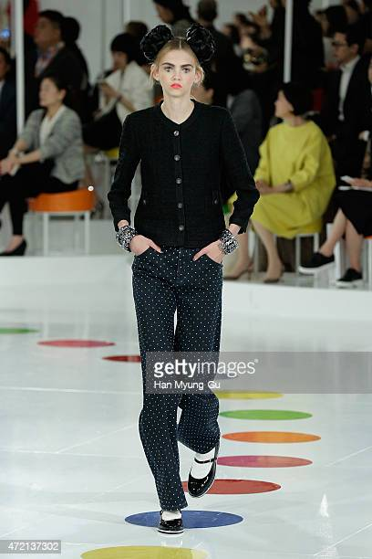 A model walks in a design by Chanel during the Chanel 2015/16 Cruise Collection on May 4 2015 in Seoul South Korea