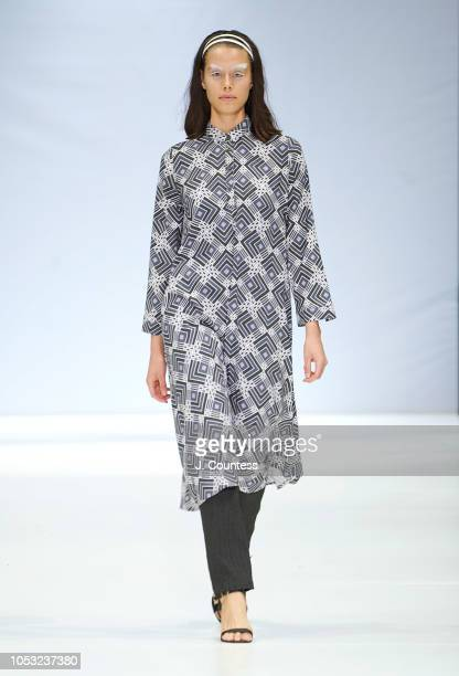A model walks in Amanda Laird Cherry on day 2 of the autumn/winter 2019 collections at South Africa Fashion Week at Sandton City Mall on October 24...