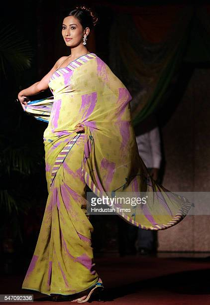 Model walks in Saree during Pitambari' Fashion Show at Bajaj Bhavan