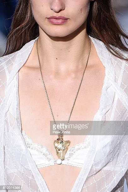 A model walks necklace detail the runway during the John Galliano show as part of the Paris Fashion Week Womenswear Spring/Summer 2017 on October 2...