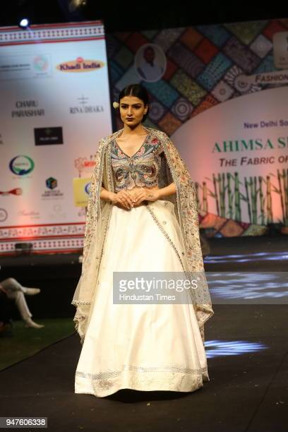 A model walks on ramp during the Fashion Show to promote Ahimsa Silk and Khadi on April 1 2018 in New Delhi India
