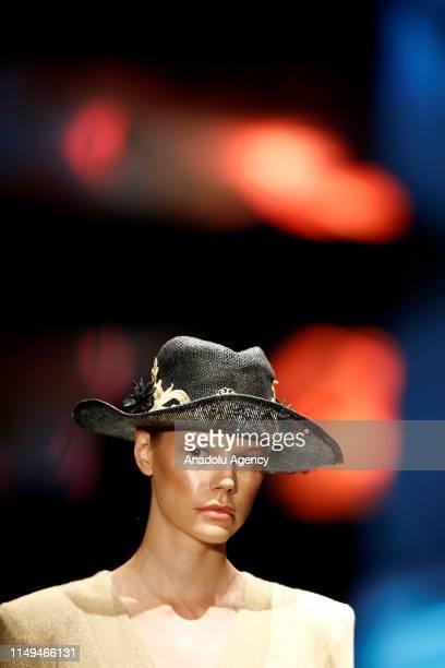 Model walks on runway at Dosso Dossi Fashion Show in Antalya, Turkey on June 12, 2019.