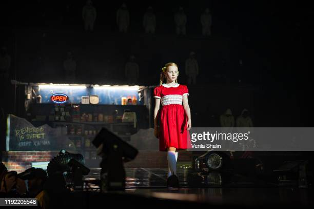 A model walks on stage before Krept Konan perform at The O2 Arena on December 5 2019 in London England