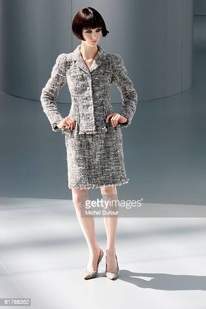 A model walks on the catwalk at the Chanel Haute Couture Autumn Winter 2008 fashion show on July 1 2008 in Paris France