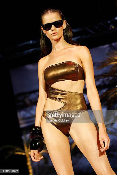 A model walks on the catwalk during the 'Michalsky StyleNite' during MercedesBenz Fashion Week Berlin Spring/Summer 2012 at Tempodrom on July 8 2011...