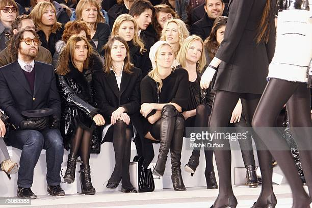 Model walks on the catwalk next to Sean Lennon, Karine Roitfeld, Sofia Coppola, Diane Kruger and Kate Bosworth at the Chanel Fashion show, during...