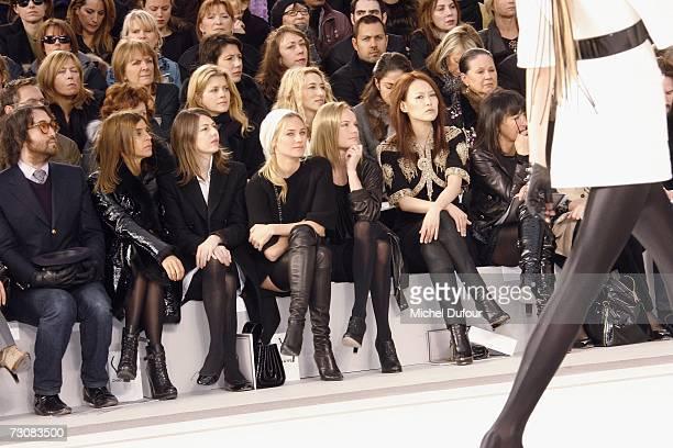 A model walks on the catwalk next to Sean Lennon Karine Roitfeld Sofia Coppola Diane Kruger Kate Bosworth and Rinko Kikuchi at the Chanel Fashion...