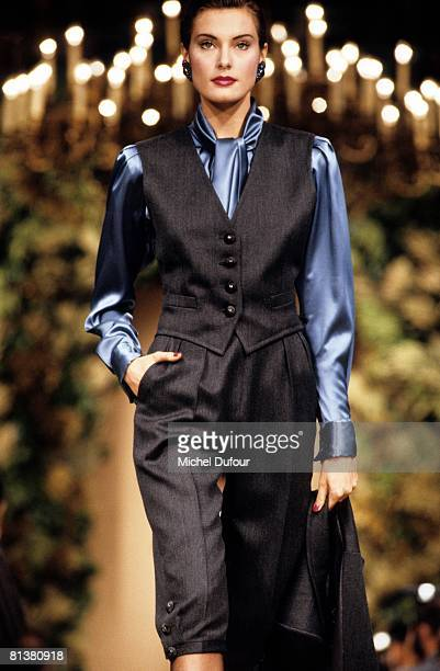 A model walks on the catwalks at YSL High Fashion Show Autumn/Winter 199394 during the fashion week 1993 in Paris France