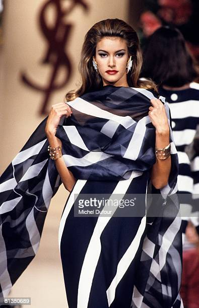 A model walks on the catwalks at YSL High Fashion Show Spring/Summer 1992 during the fashion week 1991 in Paris France