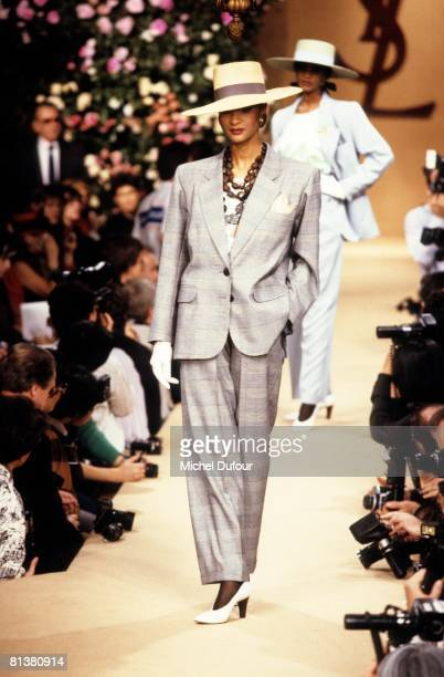 A model walks on the catwalks at YSL High Fashion Show Spring/Summer 1990 during the fashion week 1989 in Paris France