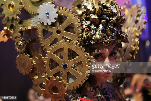 A model walks on the podium during the OMC Hairworld World Cup '3D world of art' contest on May 4 2014 in Frankfurt am Main Germany The OMC Hairworld...