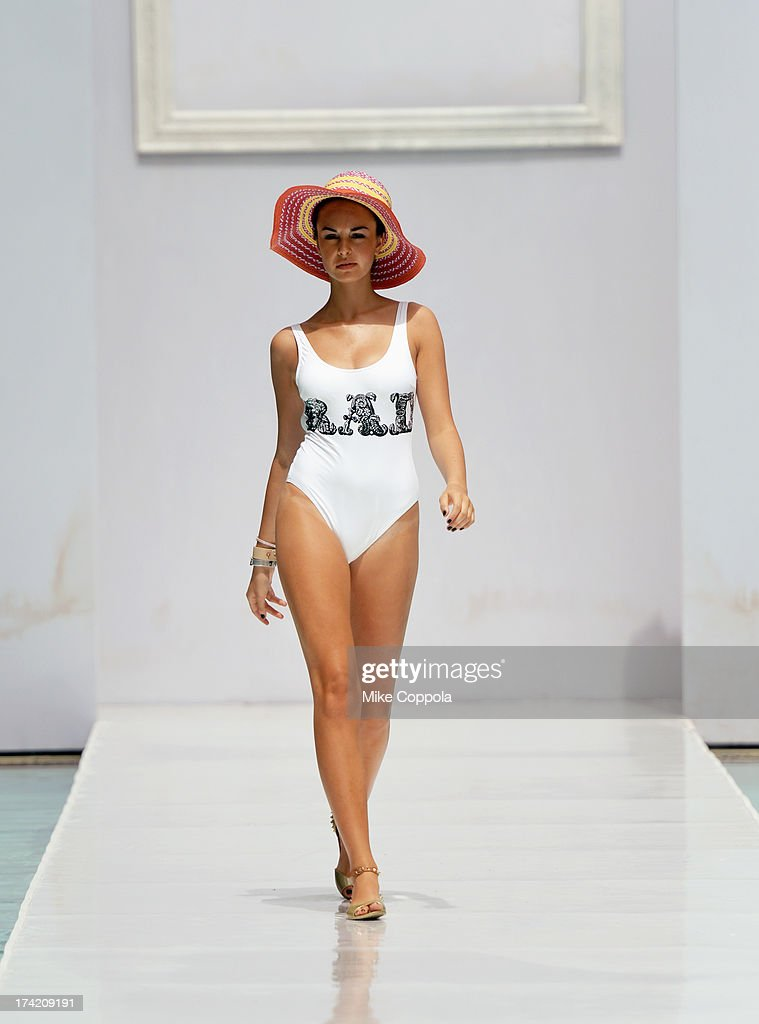 A model walks on the runway at the BCBGeneration show during Mercedes-Benz Fashion Week Swim 2014 at the SLS Hotel on July 21, 2013 in Miami, Florida.
