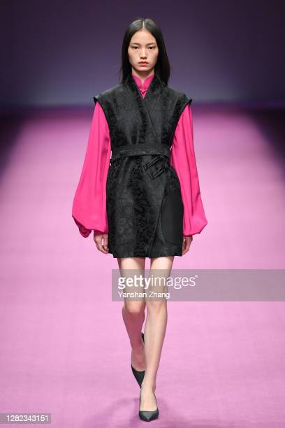A model walks on the runway at the Beautyberry Prime Show by designer Yutao Wang on day 3 of China Fashion Week at 751DPARK on October 26 2020 in...