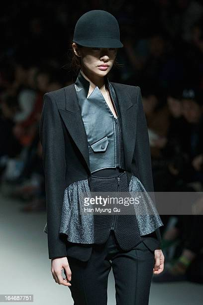 A model walks on the runway at the 'KAAL E SUKTAE' show on day two of the Seoul Fashion Week F/W 2013 at IFC Seoul on March 26 2013 in Seoul South...
