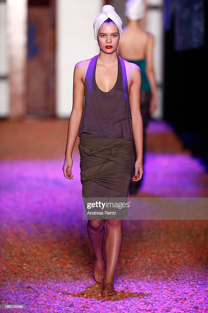 A model walks on the runway at the Maroussia Zaitseva show during Mercedes-Benz Fashion Week Russia S/S 2014 on October 29, 2013 in Moscow, Russia.
