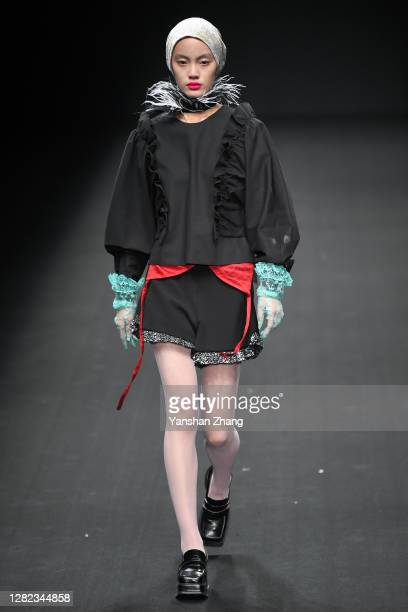 A model walks on the runway at the YONG X Show by designer Xing Yong on day 3 of China Fashion Week at 751DPARK on October 26 2020 in Beijing China