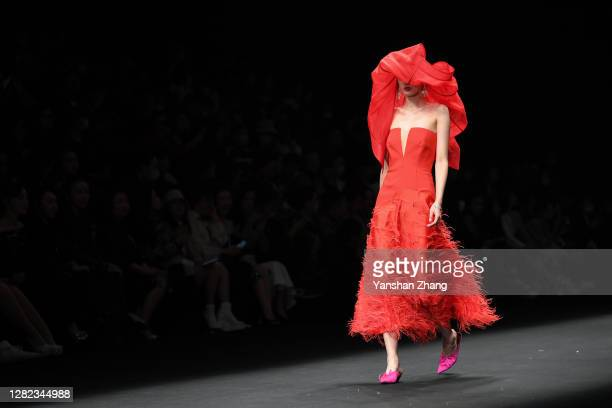 Model walks on the runway at the YONG X Show by designer Xing Yong on day 3 of China Fashion Week at 751D.PARK on October 26, 2020 in Beijing, China.