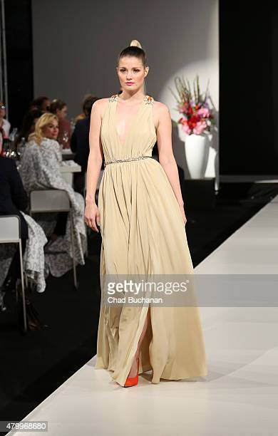 A model walks on the runway at TULPEN DESIGN by Manuel Kirchner fashion dinner on July 8 2015 in Berlin Germany