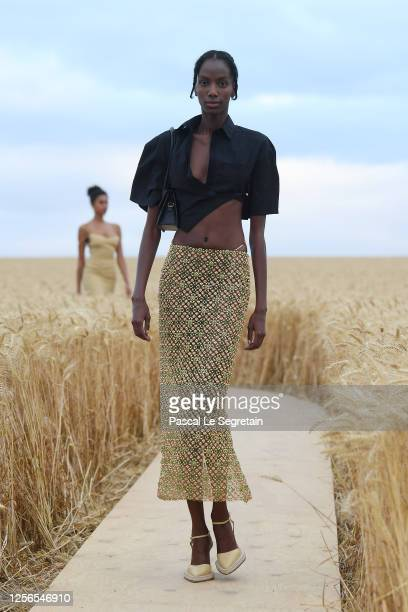 "Model walks on the runway during ""L'Amour"" : Jacquemus Spring-Summer 2021 Show on July 16, 2020 in Paris, France."