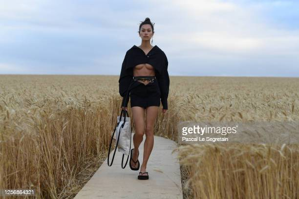 """Model walks on the runway during """"L'Amour"""" : Jacquemus Spring-Summer 2021 Show on July 16, 2020 in Paris, France."""