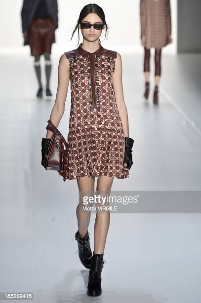 Model walks on the runway during the Colcci show during Sao Paulo Fashion Week Winter/Fall 2013 on October 30, 2012 in Sao Paulo, Brazil.