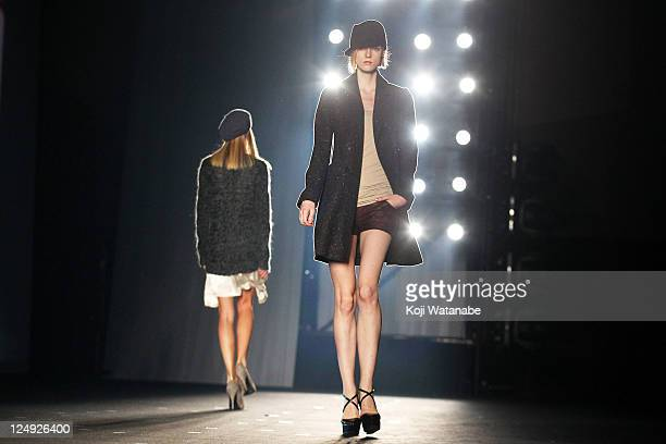 Model walks on the runway during the fast retailing fashion show at Pacifico Yokohama on September 14, 2011 in Yokohama, Japan.