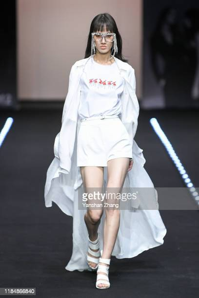 A model walks on the runway during the JEFEN Show in the China Fashion Week on November 01 2019 in Beijing China