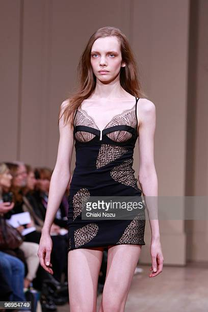 Model walks on the runway during the Julien Macdonald show for London Fashion Week Autumn/Winter 2010 at Banqueting House on February 21, 2010 in...