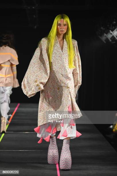 A model walks on the runway during the MIKIO SAKABE show as part of Amazon Fashion Week Tokyo 2018 S/S at Omotesando Hills on October 21 2017 in...
