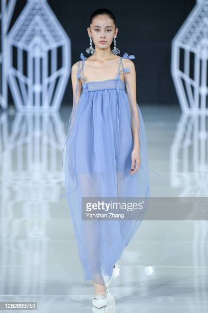 A model walks on the runway during the OU Show by designer Xu Hua on day 5 of China Fashion Week at 751DPARK on October 28 2020 in Beijing China