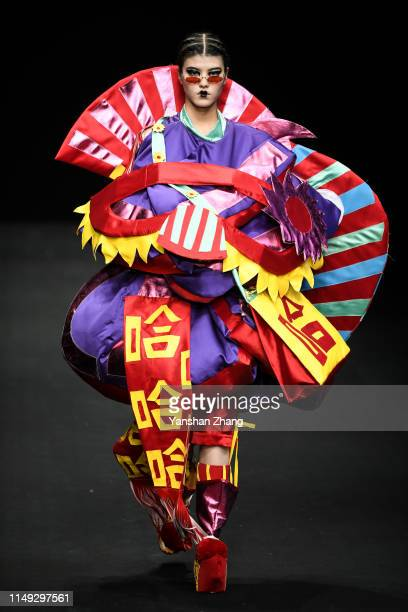 Model walks on the runway during the The Tourism College of Changchun University show in the China Graduate Fashion Week on May 15, 2019 in Beijing,...