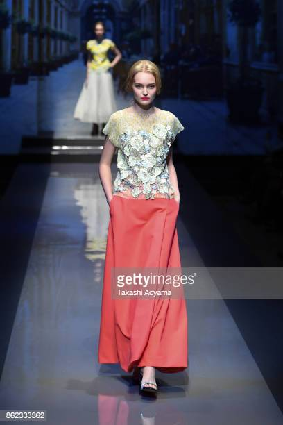 A model walks on the runway during the YUKI TORII INTERNATIONAL show as part of Amazon Fashion Week Tokyo 2018 S/S at the Garden Hall of the Yebisu...