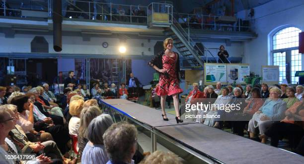 A model walks on the runway in a 50yearold dress during a fashion show with the title 'Heinz Bormann from the red Dior of the GDR up to today's...