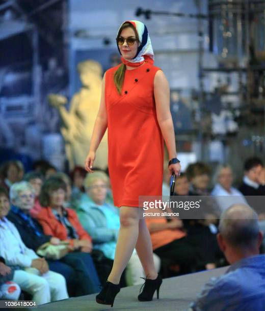 A model walks on the runway in a 60yearold dress during a fashion show with the title 'Heinz Bormann from the red Dior of the GDR up to today's...